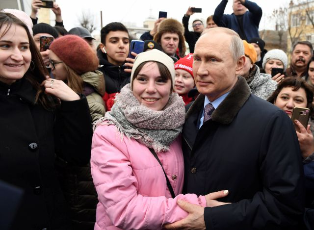 FILE - In this March 6, 2020, file photo, Russian President Vladimir Putin, right, poses for a photo with local citizens in Ivanovo, Russia. Putin is just a step away from bringing about the constitutional changes that would allow him to extend his rule until 2036. The vote that would reset the clock on Putin's tenure in office and allow him to serve two more six-year terms is set to wrap up Wednesday, July 1, 2020. (Alexei Nikolsky/Sputnik, Kremlin Pool Photo via AP, File)