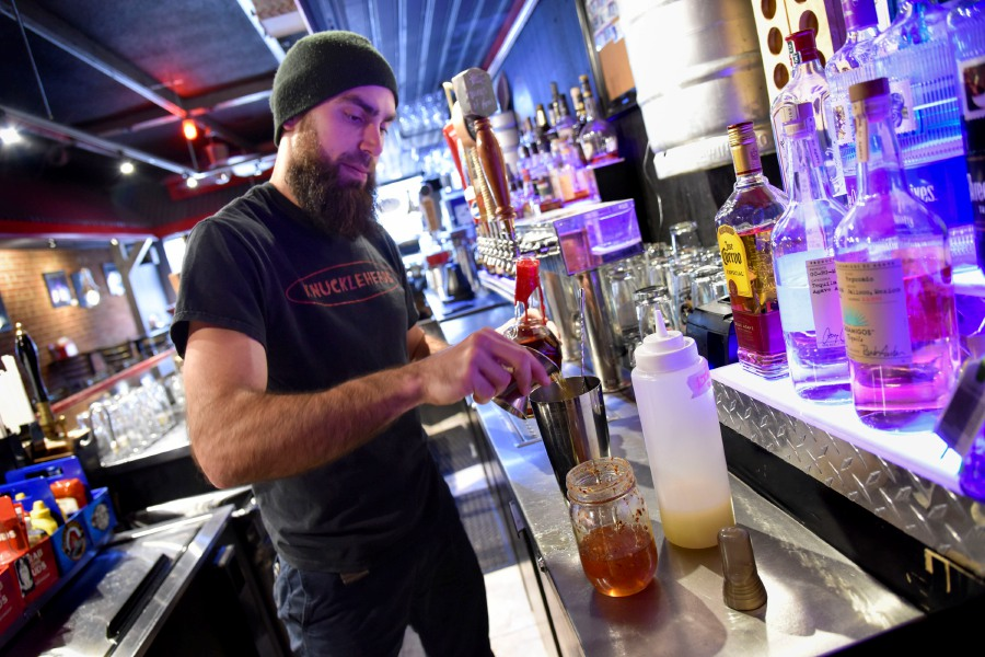 "Head Bartender Anthony Dorsey makes a ""Metal Maker"" drink at Knuckleheads in Wallingford on Wednesday."
