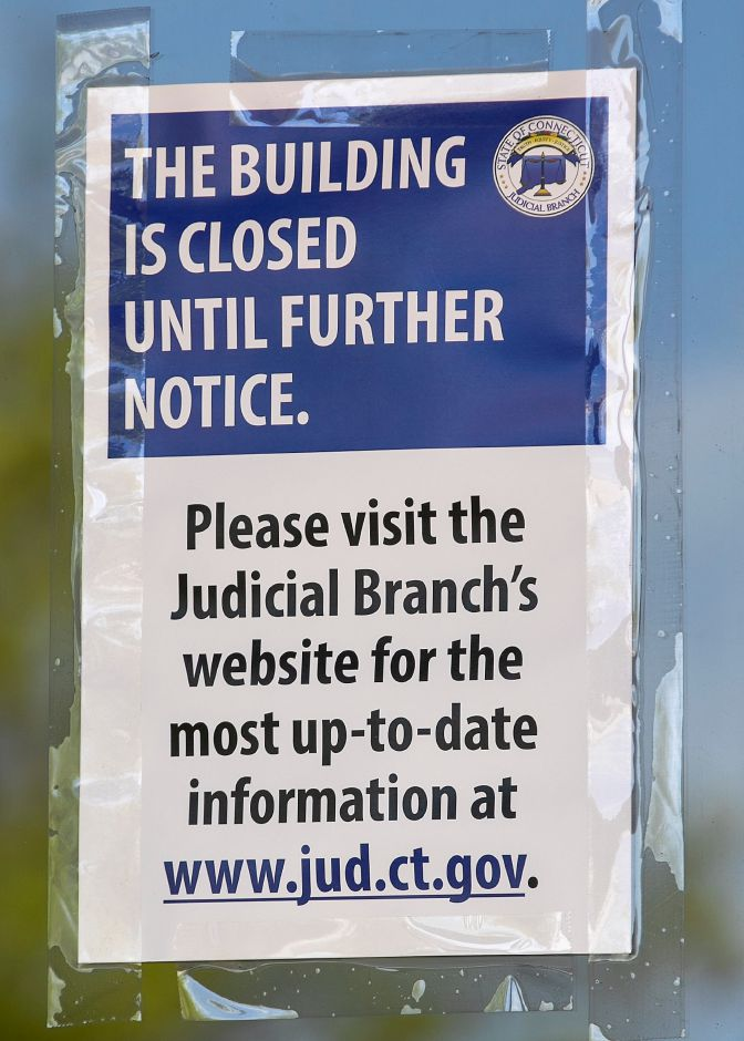 "One of several ""building closed"" signs displayed Friday on the front doors of the State of Connecticut Superior Court at 54 W. Main St. in Meriden. Photos by Dave Zajac, Record-Journal"