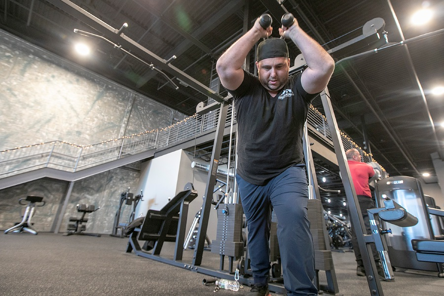 Steve Fatone, of North Haven, works his triceps at Surge Fitness Center in North Haven on Friday. The new fitness center opened in December. Photos by Dave Zajac, Record-Journal