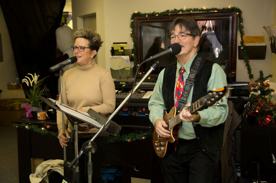Kelley and Sean Moore perform Christmas songs in the office of EZ Out Bail Bonds during the Downtown Meriden Holiday Extravaganza Saturday, Dec. 12, 2015. | Christopher Zajac / Special to the Record-Journal