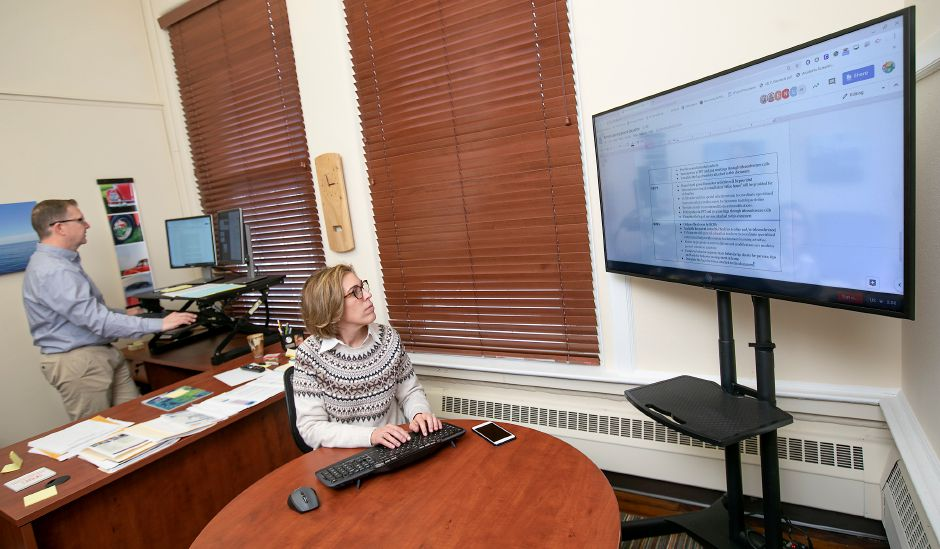 In this file photo, Kevin Hanlon, K-8 curriculum coordinator, and Marlene Silano, assistant superintendent, prepare Cheshire schools for remote learning, Tues., Mar. 17, 2020. Dave Zajac, Record-Journal