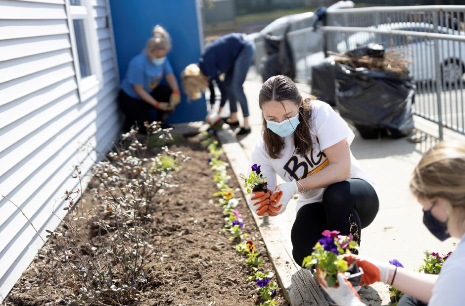 Quinnipiac University volunteers plant flowers at the Ulbrich Boys & Girls Club in Wallingford as part of the annual Big Event.