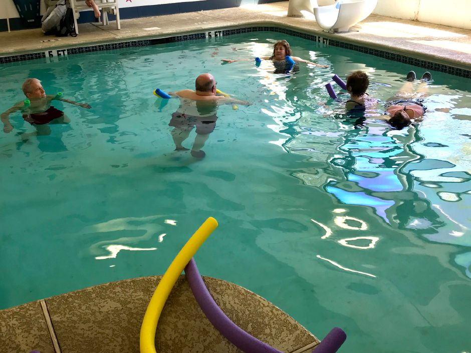An aquatic exercise class in the therapy pool at the Wallingford YMCA helps those with Parkinson