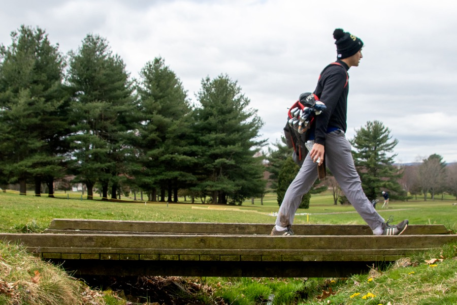 Jake Napoli, of Southington, crosses over a bridge to the seventh green as he plays a round of golf with friends at the Southington Country Club on Tuesday, March 31, 2020. Aaron Flaum, Record-Journal