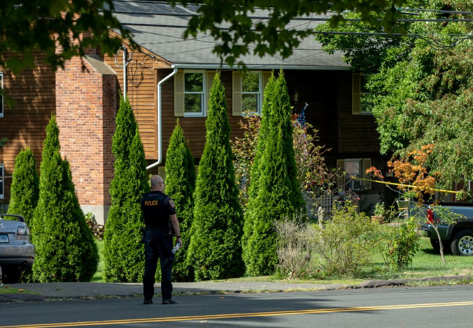 A Meriden Police officer stands outside 115 Allen Avenue in Meriden, where a fatal shooting occurred on August 11, 2019. | Devin Leith-Yessian/Record-Journal
