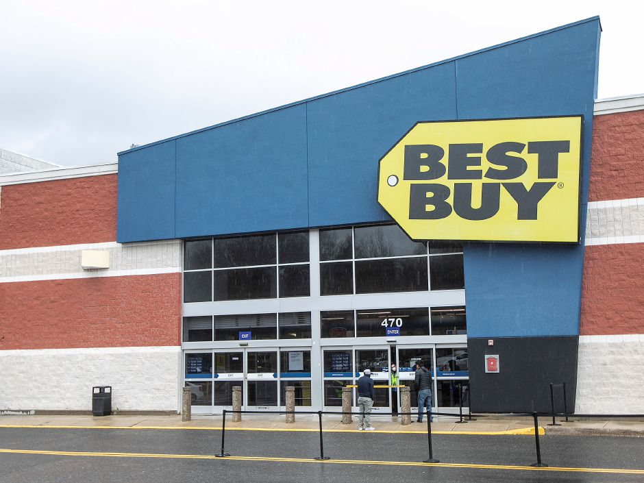 A Best Buy employee talks to customers in front of the store at the Westfield Meriden mall, Tues., Apr. 21, 2020. Dave Zajac, Record-Journal