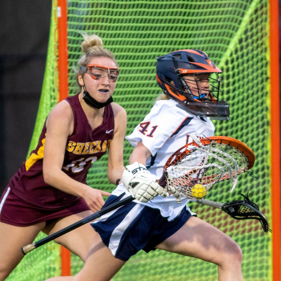 Lyman Hall goalie Lauren Cretella, seen here in action earlier this season against Mikayla-Lynn Van Dyke and Sheehan, backboned the defense in net and also generated some offense in the Trojans' 10-3 lacrosse victory over Foran on Thursday night. Aaron Flaum, Record-Journal