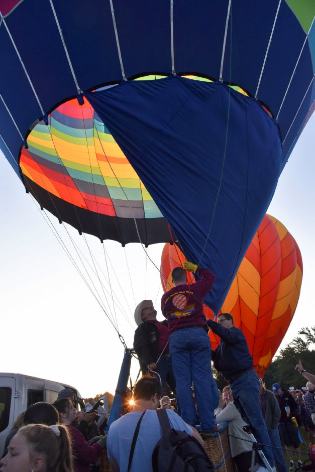 Hundreds gathered at Norton Park Saturday morning, August 24, to watch the first sunrise balloon launch of the weekend, during this year