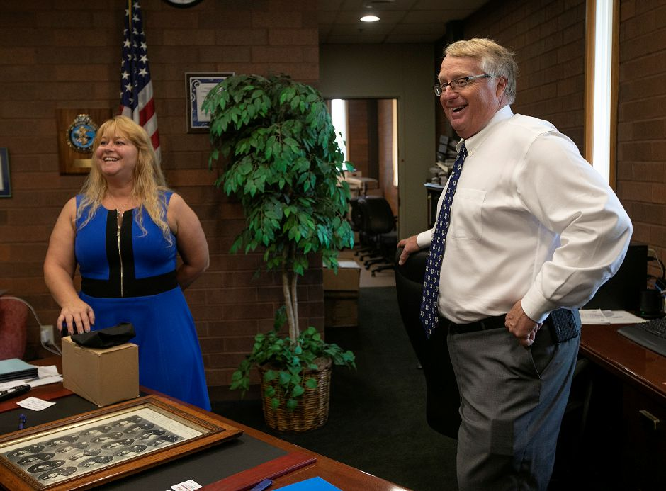 Chief Jeffry Cossette and Sheri DeLuca share smiles after DeLuca donated a 113-year-old framed photograph of police department members to Meriden police, Wed., July 24, 2019. The Meriden Historical Society coordinated the donation of the photograph during a ceremony held at the police station on Wednesday. The photograph was found in the belongings of Dan DeLuca, a former teacher and local historian, by his daughter after he died three years ago. Dave Zajac, Record-Journal