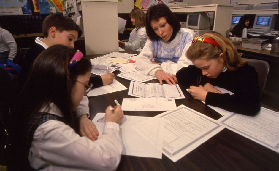 RJ file photo - Aileen Gonzalez, T.J. Kronenberger and Sara Loos make posters with their instructor Jackie Shea, at St. Stanislaus School in Meriden March 2, 1994.