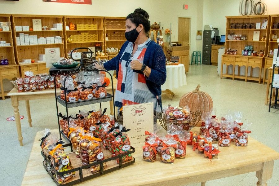 Thompson Chocolate store manager Kim Poole shows off the displays inside the store on South Vine Street in Meriden, which reopened this week. Photos by Aaron Flaum, Record-Journal