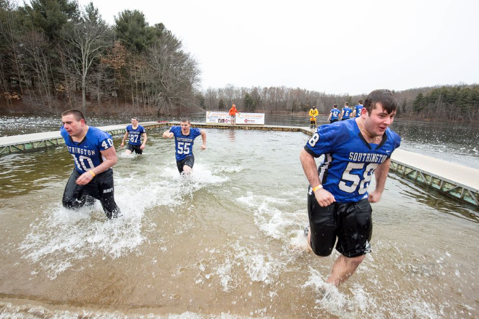 Southington High School football players run onto the beach and out of the icy waters of Sloper pond in Southington, January 18, 2020. The 15th annual Sloper Plunge by the Southington-Cheshire Community YMCAs raises money for local kids to attend camp. Photo by David Torrellas, special to the Record-Journal.