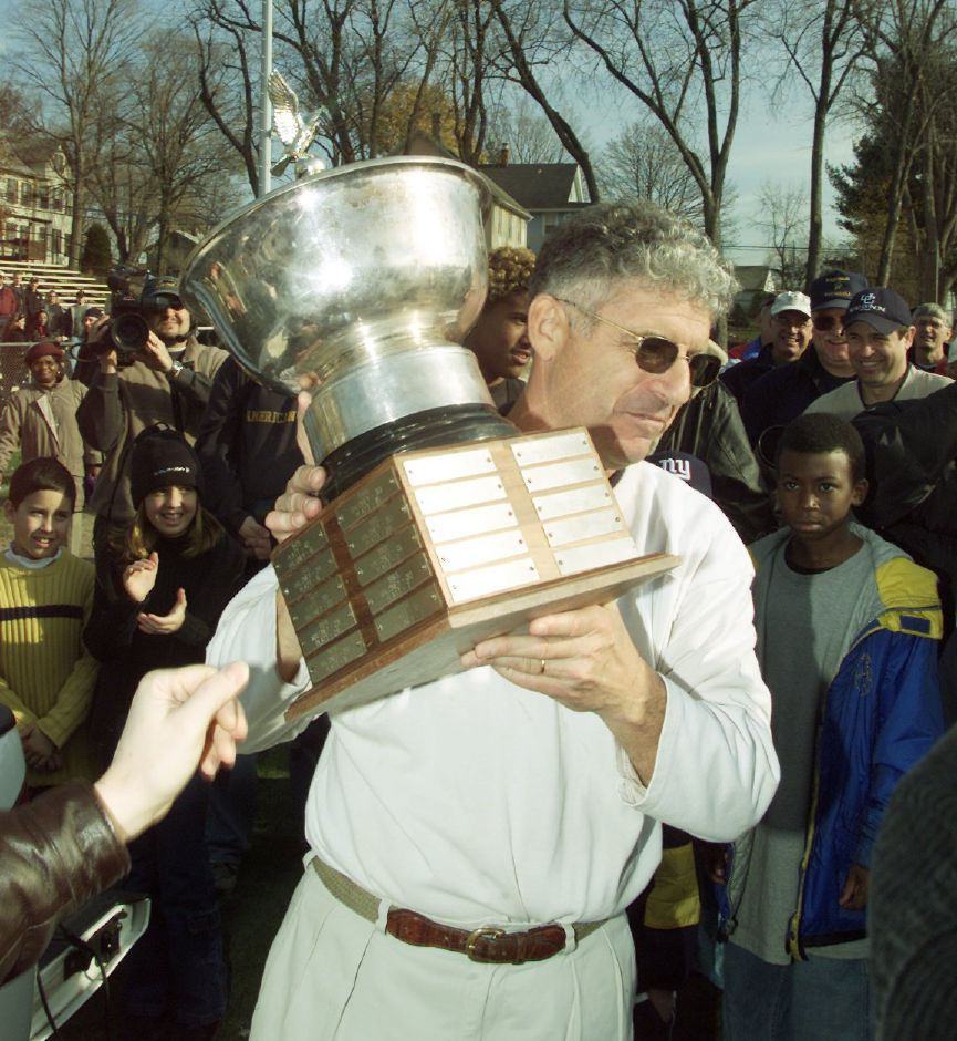 Platt coach Tom Ryan celebrates his team's victory in the 2001 Stoddard Bowl, a game that included future Maloney coach Kevin Frederick. Record-Journal file photo