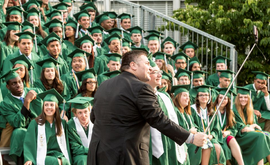 Mark Hughes, President of the Board of Education, takes a selfie with class president Michael Rider in front of the 238 graduating seniors of Maloney High School in Meriden, Friday evening, June 19, 2015. (Christopher Zajac / For the Record-Journal)