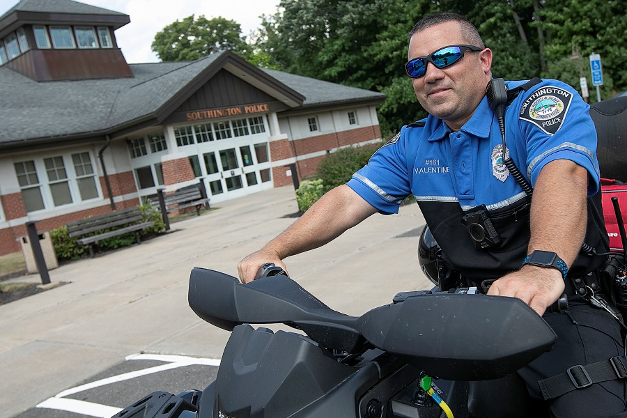 Police Officer Jim Valentine shows one of two quads owned by the Southington Police Department on  July 29, 2019. Water Department officials are considering new all-terrain vehicles for police to use during trespassing patrols and rescues. Dave Zajac, Record-Journal file photo