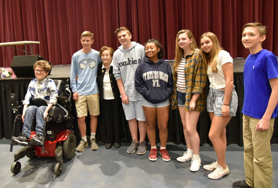 Holocaust survivor Judith Altmann poses with North Haven Middle School students on Friday, May 24, 2019. | Bailey Wright, Record-Journal