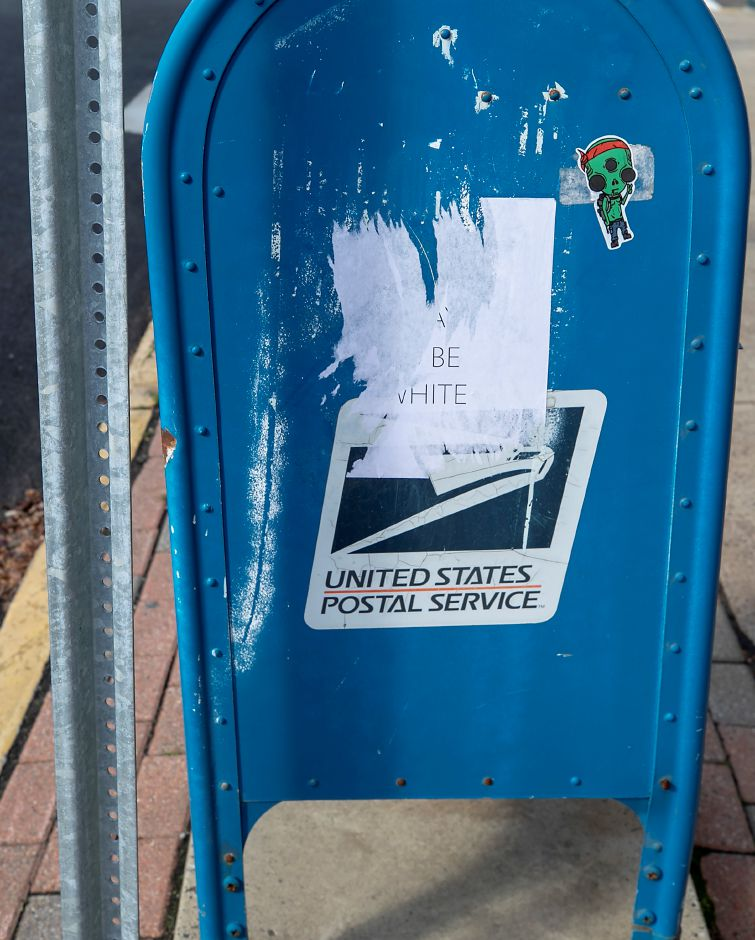 "A flyer pasted to a post office box along Center Street in Wallingford reads ""It's okay to be white,"" Mon., Nov. 2, 2020. According to the Anti-Defamation League, the phrase ""It's okay to be white"" originated in the white supremacist movement and has been popularized by members of the controversial online discussion forum 4chan. The flyer has been partially removed. Dave Zajac, Record-Journal"