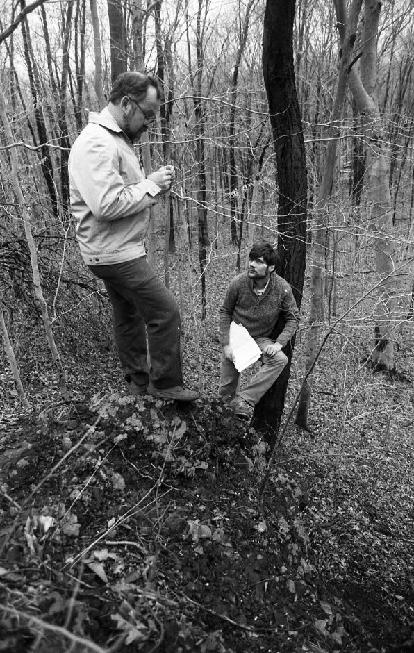 RJ file photo - Wallingford Inland Wetlands Commission Chairman Jim Heilman and town Environmental Planner Robert Baker examine a site they say contains evidence of volcanic activity, April 1989.