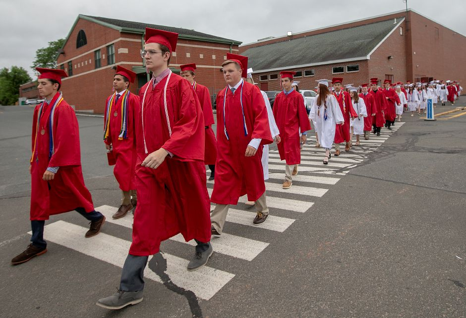 Members of Cheshire High School's Class of 2019 seen during a procession to their graduation ceremony. Cheshire school officials announced on Friday that Sunday's graduation, will be a drive-thru event, after recent positive COVID-19 cases were identified that would have impacted an in-person event.Dave Zajac, Record-Journal file photo