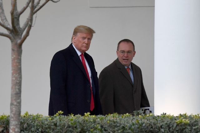 FILE - In this Jan. 13, 2020. file photo, President Donald Trump, left, and acting White House chief of staff Mick Mulvaney, right, walk along the colonnade of the White House in Washington. The federal government