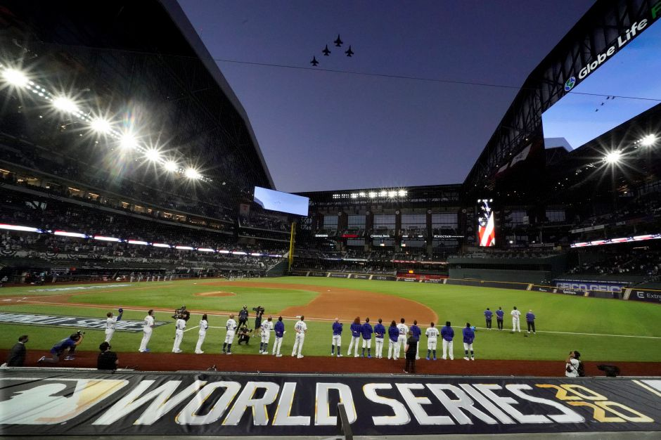 The Los Angeles Dodgers line up during during the national anthem and a fly over before Game 1 of the World Series against the Tampa Bay Rays Tuesday in Arlington, Texas. Associated Press