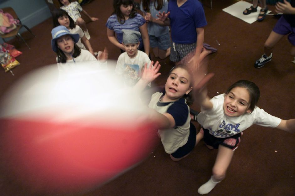 "Chrisitine Morico, left, and classmate Chelsea Garlock, right, return the volley of a beach ball in their fourth grade classroom at St. Joseph School in Meriden Jan 30, 2001. The school is participating in ""beach day"" as part of Catholic School week. Students dressed in shorts, wore sunglasses, and T-shirts as part of the event."
