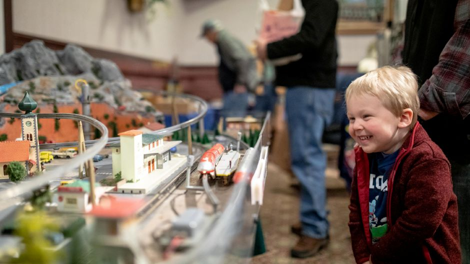 Helden Karp, 3, of Farmington, laughs as monorail trains pass by  at the Train and Toy Show held by Classic Shows LLC at Zandri