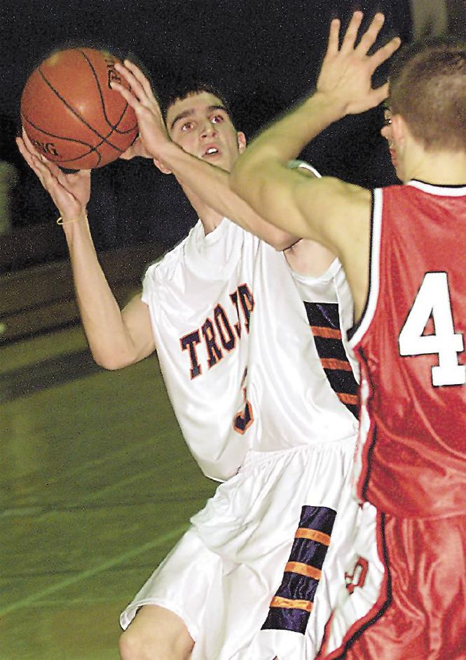 Lyman Hall Trojan co-captain Matt Lynch (left) looks to pass around Derby Red Raider Kyle Quinn during Tuesday night