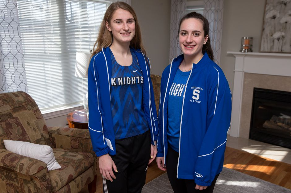 Southington seniors Sydney Garrison, left, and Trinity Cardillo won conference crowns Saturday at the CCC Indoor Track Championships at the New Haven Athletic Center. Garrison won the high juimp at 5-4 and Cardillo captured the shot put at 41-11. | Record-Journal file photo