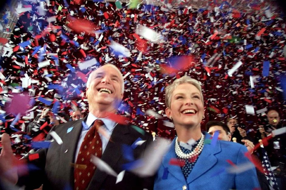 ** FILE ** In this Jan. 30, 2000 file photo, Republican presidential hopeful, Sen. John McCain, R-Ariz., and his wife Cindy, smile as confetti falls on them at the end of their 114th New Hampshire town hall meeting with voters at the Peterborough Town House in Peterborough, N.H. McCain still has his supporters in New Hampshire, a state where voters arguably know him as well if not better than his constituents back home in Arizona. (AP Photo/Stephan Savoia, File)