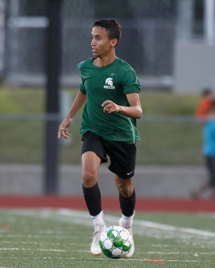 Alex Torres competes for Maloney during a preseason scrimmage at Hamden.