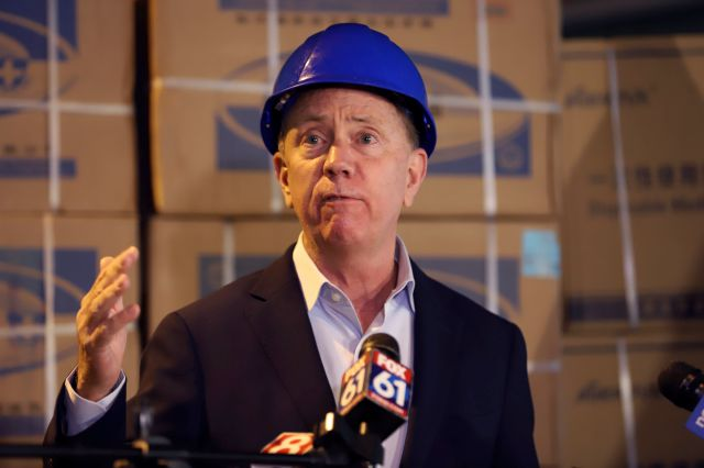 FILE: Connecticut Gov. Ned Lamont speaks to the media about the shipment of personal protective equipment from China donated to the state to aid Connecticut