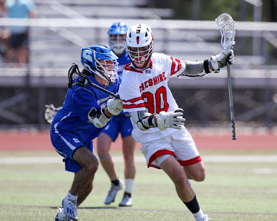 Senior co-captain Brian Bouwman scored four goals and set up four others to lead the Cheshire boys lacrosse team to an 18-4 romp over Simsbury on Saturday at Alumni Field. James Brandolini, Cheshire Herald