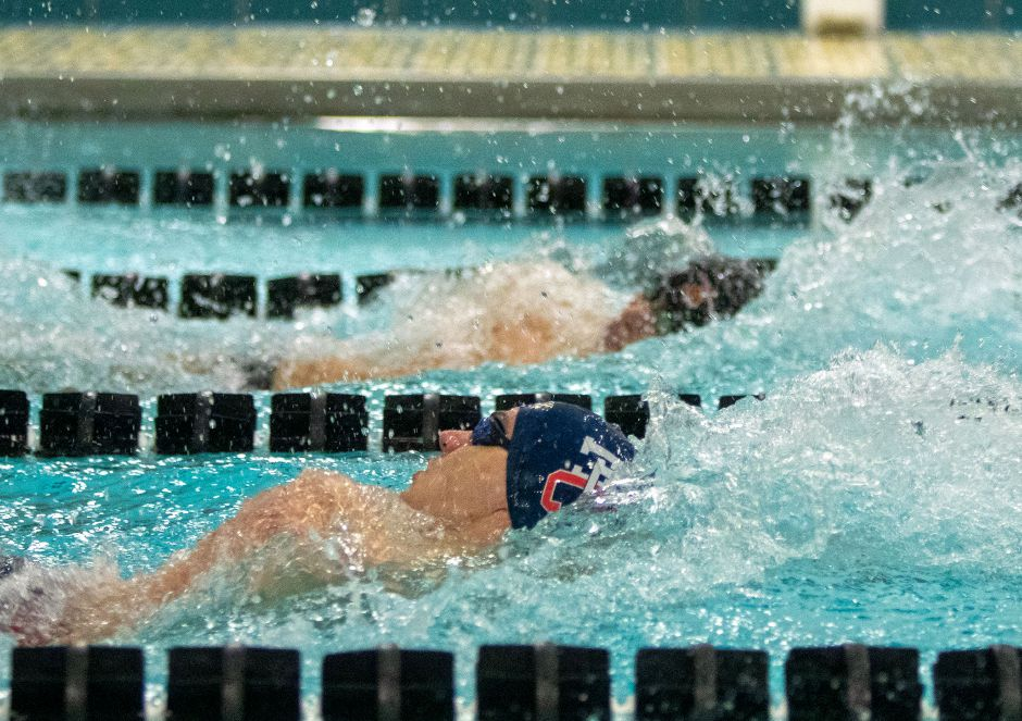 Lyman Hall/Coginchaug's Josh Ramirez (near lane) and Sheehan's Adam DiDomenico swim the backstroke during the 200 medley relay race that kicked off Wednesday's Wallingford rivalry meet at the Sheehan pool. Aaron Flaum, Record-Journal