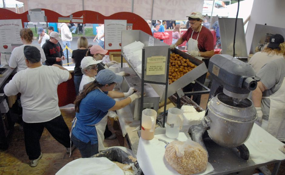 SOUTHINGTON, Connecticut - Saturday, September 27, 2008 - The apple fritter booth was a very busy place at the 2008 Apple Harvest Festival in downtown Southington on Saturday as volunteers helped out in all phases of production. Rob Beecher / Record-Journal