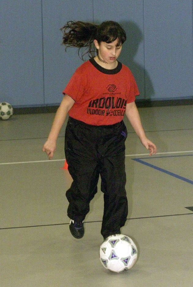 Lauren Strillacci, 8, dribbles the ball during practice for the indoor soccer program at the Meriden Boys and Girls Club Tues., Jan. 23, 2001.