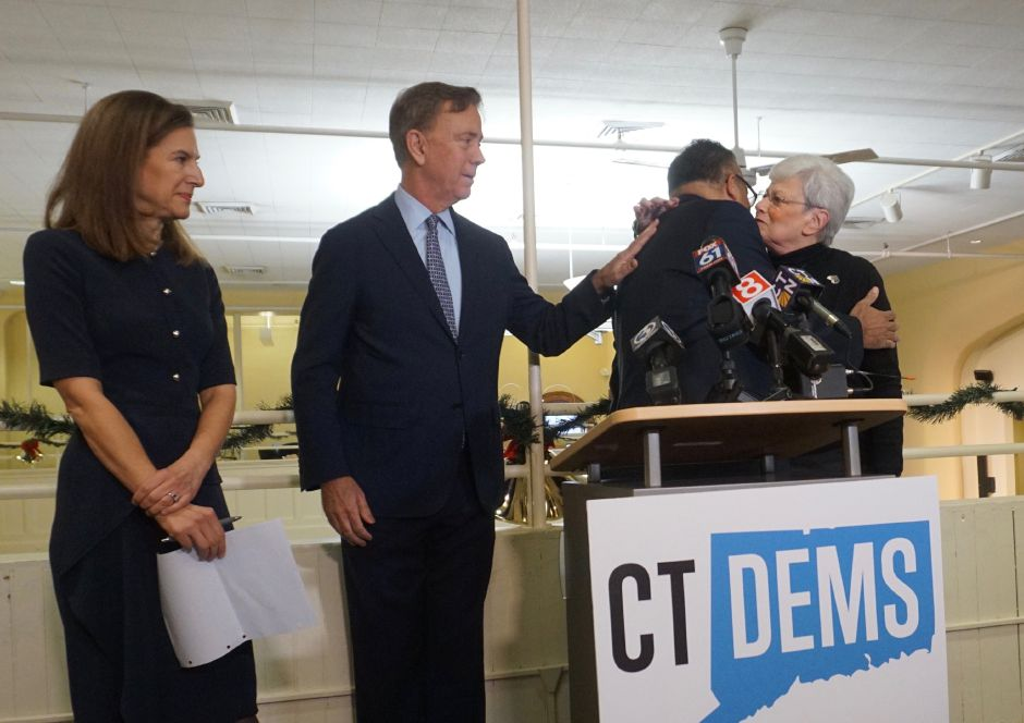 Susan Bysiewicz and Ned Lamont watch Nick Balletto embrace his successor, Nancy Wyman. in 2018. | The Connecticut Mirror