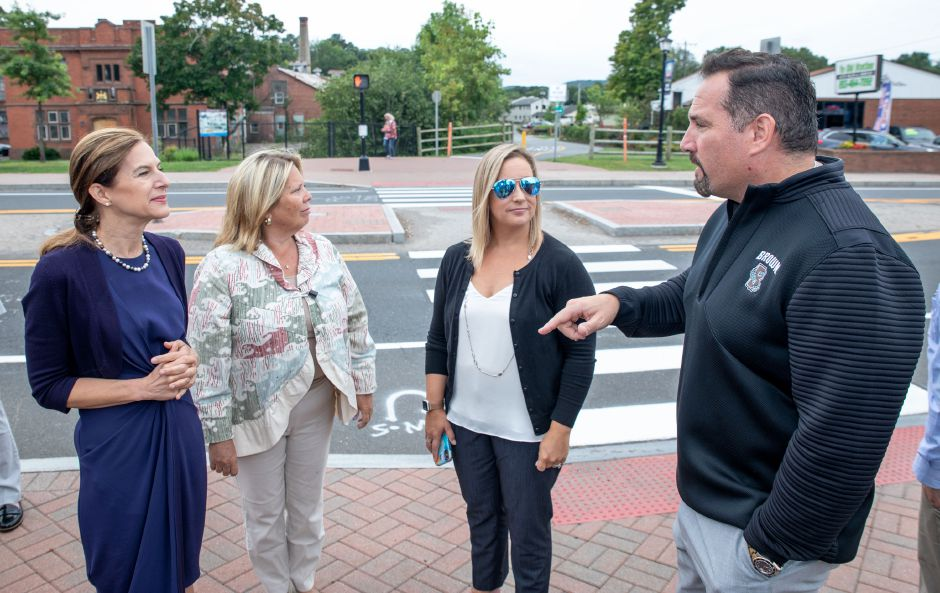 Cheshire Town Council Chairman Rob Oris, right, speaks with Lt. Gov. Susan Bysiewicz, left, state Rep. Mary Abrams and state Rep. Liz Linehan, center right, in this 2019 file photo. Police are investigating alleged threats against Oris and his family. | Devin Leith-Yessian/Record-Journal