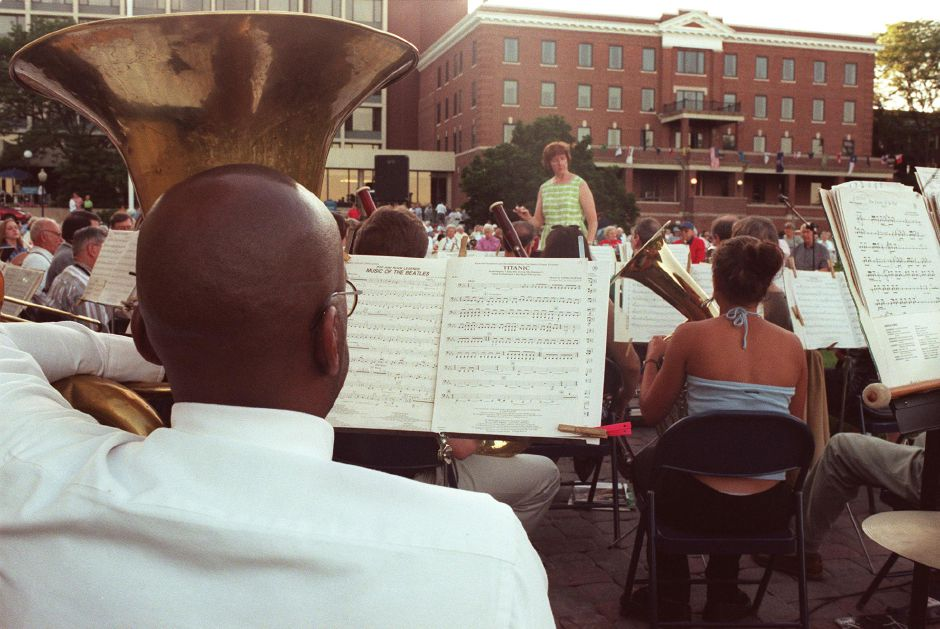 "Walter Gibson on the tuba plays music from Titanic along with others in the ""R"" Band Thursday evening at the Masonic Home July 20, 2000."