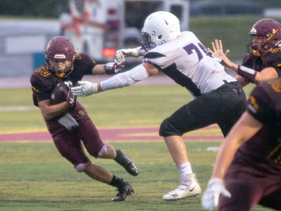 Sheehan sophomore running back Ryan Villano slips past North Branford's Sheldon Wessolock during Friday's scrimmage at Riccitelli Field | Aaron Flaum, Record-Journal