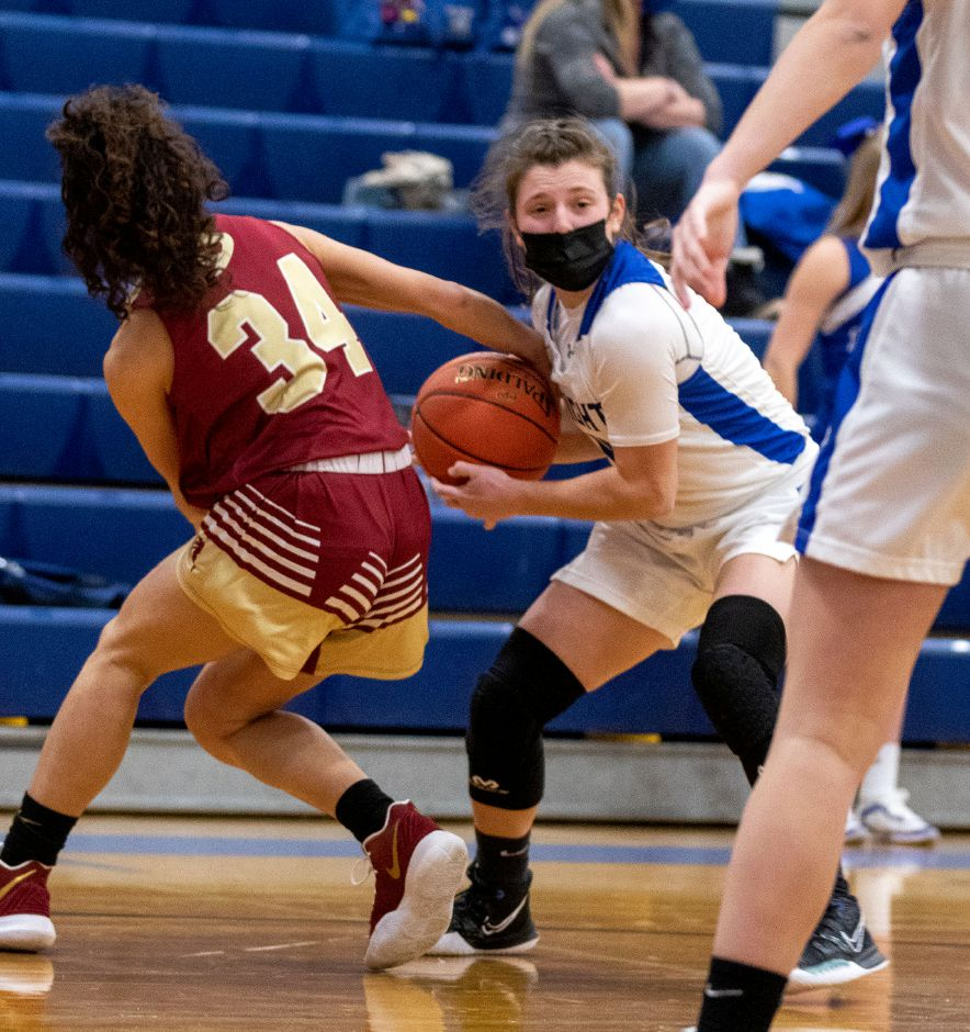 Southington's Livvy Pizzitola wrestls the ball away from New Britain's Layla Mejia during the first half at Southington High School on Wednesday, Feb. 10, 2021. Aaron Flaum, Record-Journal