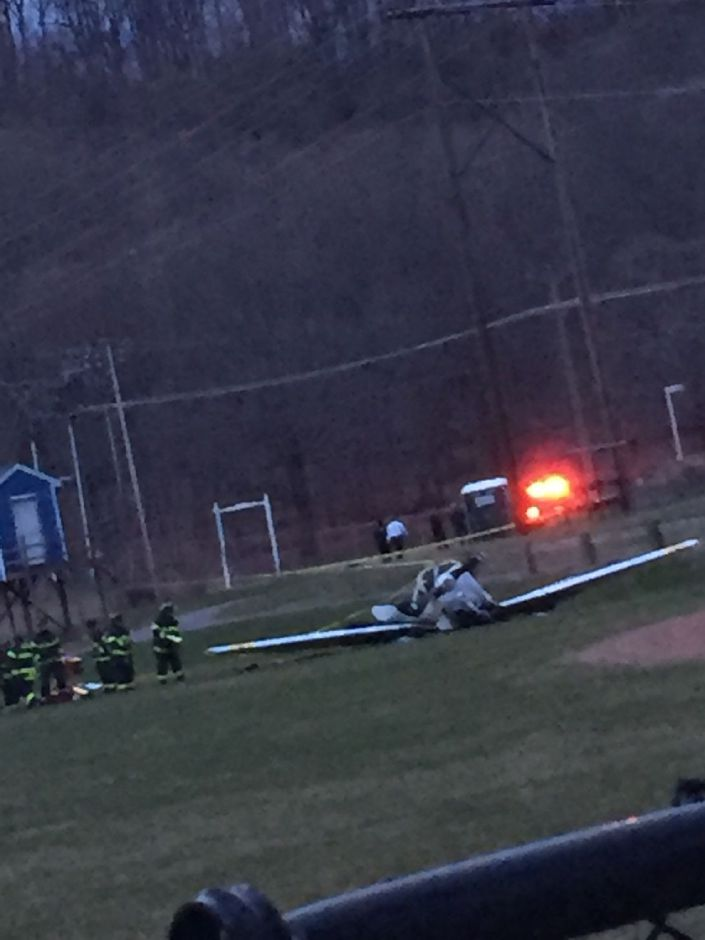 Emergency crews tend to a plane that crashed on the fields at Wilcox Technical High School Thursday April 11, 2019. | Courtesy of Kieara Parker