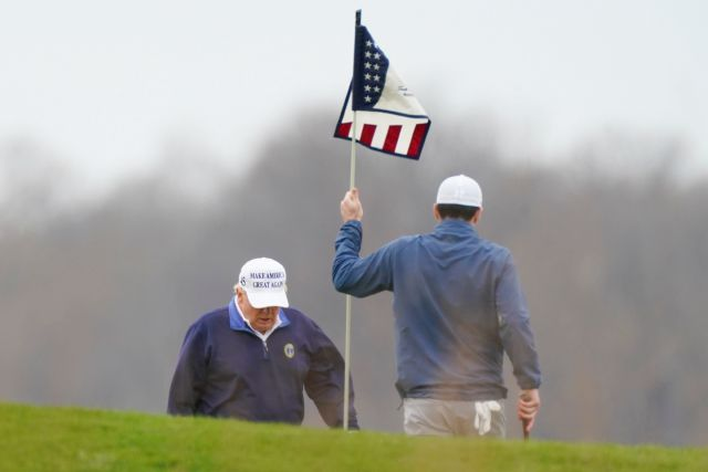 President Donald Trump plays golf at Trump National Golf Club in Sterling, Va., Sunday, Nov. 22, 2020. (AP Photo/Manuel Balce Ceneta)