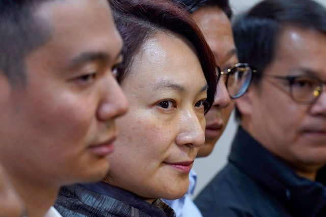 Starry Lee, chairperson of pro-Beijing party Democratic Alliance for Betterment of Hong Kong (DAB), center, looks during a press conference with her candidates following their defeat in the local district council election in Hong Kong, Monday, Nov. 25, 2019. The pro-democracy opposition appears to have swept to a resounding victory in Hong Kong elections, as a record turnout dealt a clear rebuke to city leader Carrie Lam and her handling of violent protests that have divided the Chinese...