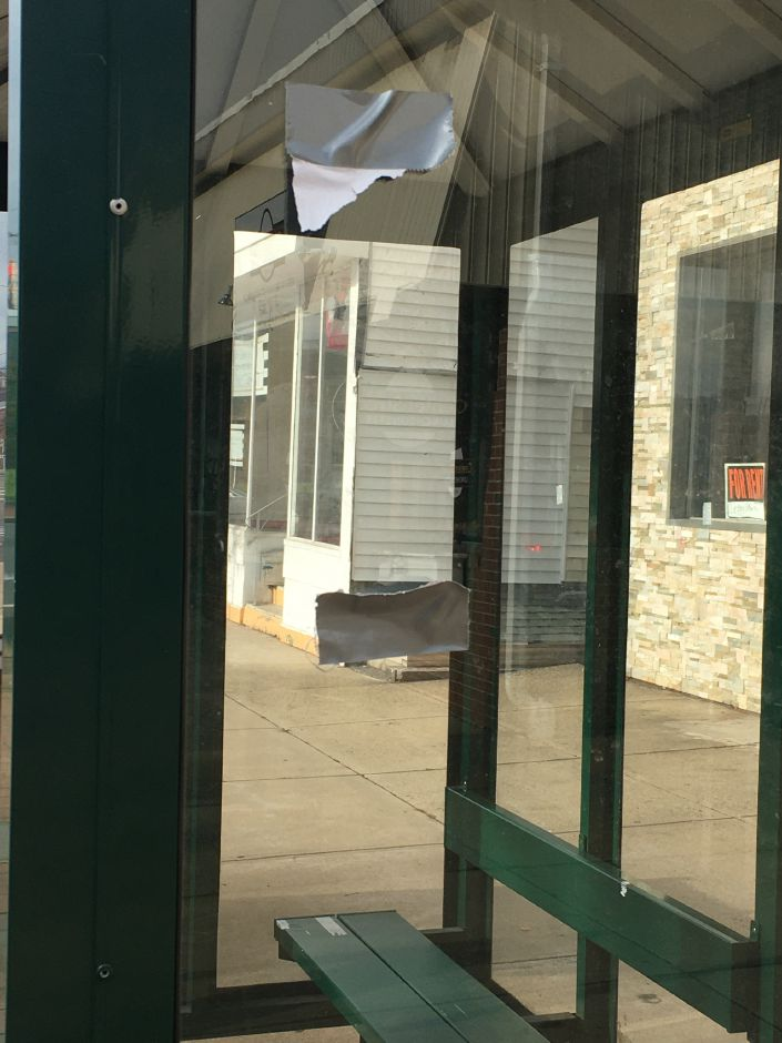 "Flyers with a racial message appeared Sunday, Nov. 10, 2019, around downtown Wallingford for the second consecutive weekend. A remnant of the flyer with the message ""It's okay to be white"" was observed on a bus stop shelter on Center Street near Route 5. 