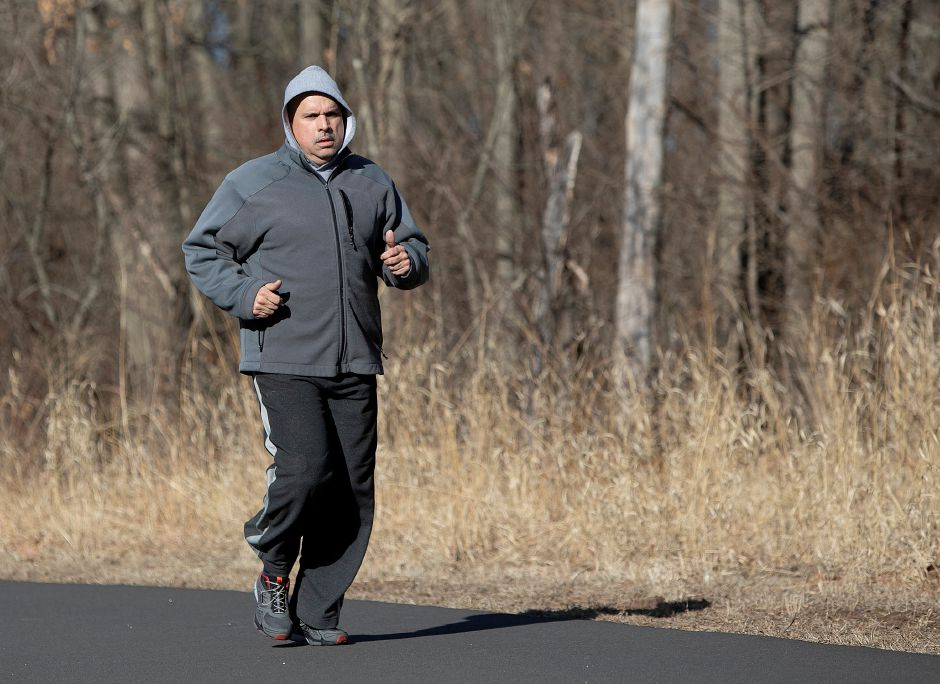 Wilfredo Cruz, of Wallingford, jogs on the Quinnipiac River Linear Trail, Tues., Feb. 26, 2019.  Work on a paved recreational trail from the Wallingford Senior Center to the Community Lake area is expected to start in April.. Dave Zajac, Record-Journal