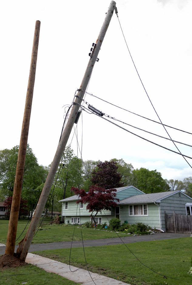 Downed wires next to a house at 28 Balsam Rd. in Wallingford, Thursday, May 17, 2018. The area was hit hard by Tuesday