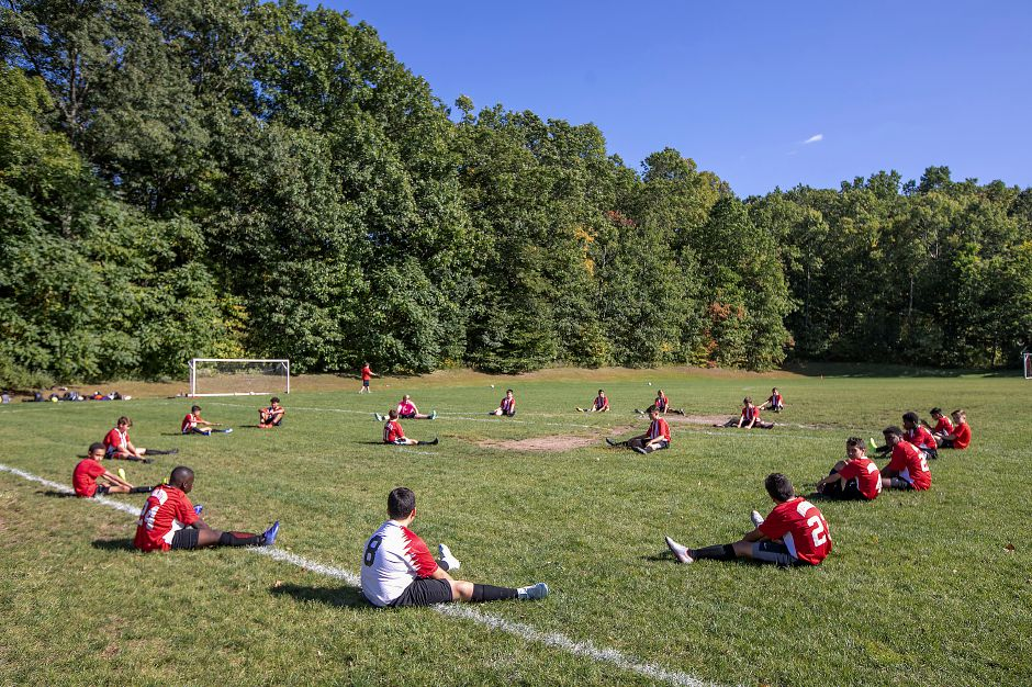 The Washington Middle School soccer team stretches prior to the match.