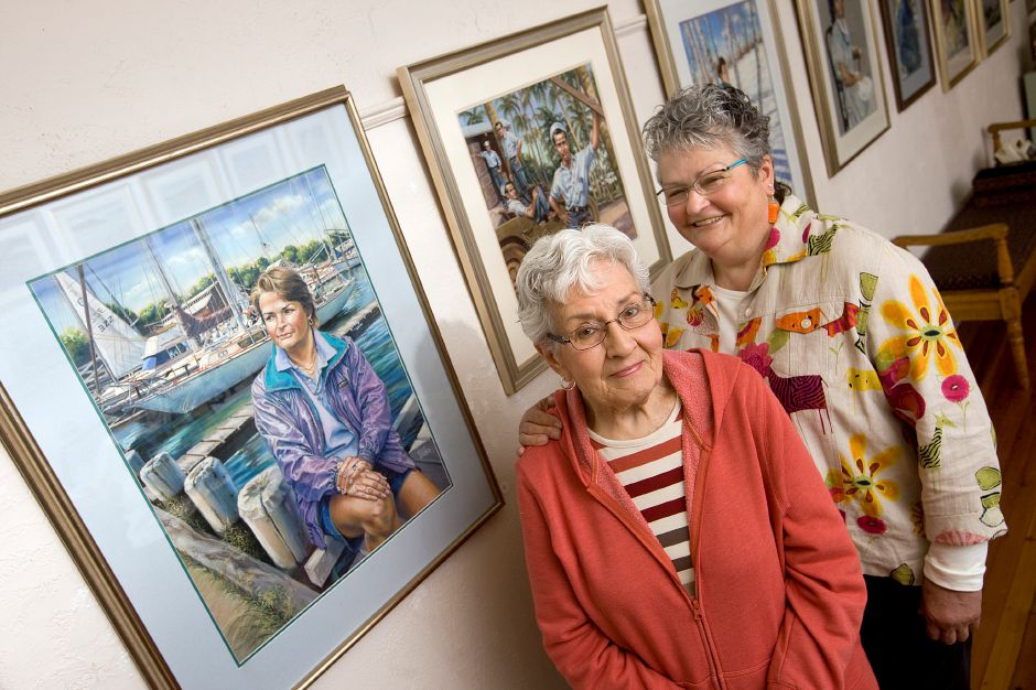 Artist Ellie Bender of Meriden and daughter Chris Bender Webster stand at Gallery 53 during a show featuring their work in May 2014.